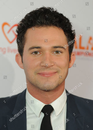 Justin Willman arrives at the CoachArt Gala of Champions held at The Beverly Hilton, in Beverly Hills, Calif