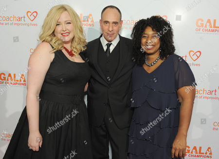From left, Katrina Parker, Nestor Serrano, and Thyonne Gordon arrive at the CoachArt Gala of Champions held at The Beverly Hilton, in Beverly Hills, Calif