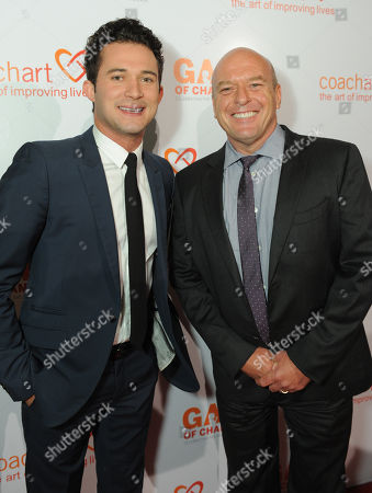 Justin Willman, left, and Dean Norris arrive at the CoachArt Gala of Champions held at The Beverly Hilton, in Beverly Hills, Calif