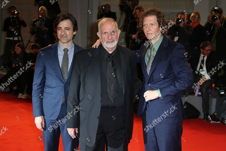 From left, Noah Baumbach, director Brian De Palma and Jake Paltrow pose for photographers as they walk the red carpet for the documentary film De Palma prior to De Palma collecting the Glory to the Filmmaker Award, during the 72nd edition of the Venice Film Festival in Venice, Italy