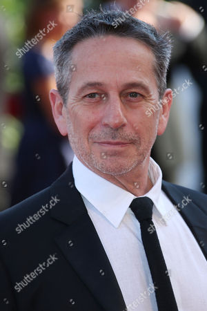Alfredo Castro poses for photographers during the red carpet for the film, Desde Alla (From afar) at the 72nd edition of the Venice Film Festival in Venice, Italy, . The 72nd edition of the festival runs until Sept. 12