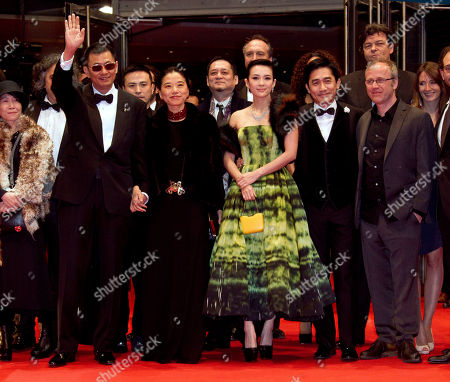 Stock Image of From left, director Wong Kar Wai and his wife Esther Wong, actors Zhang Ziyi, Tony Leung and cameraman Philippe Le Sourd tarrive on the red carpet for the screening of the film The Grandmaster at the 63rd edition of the Berlinale, International Film Festival in Berlin, Thursday, Feb.7,2013