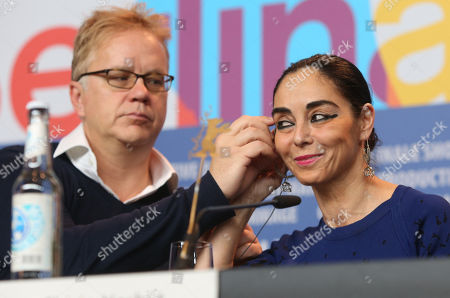 Tim Robbins adjusts the headset of Shirin Neshat during the jury press conference at the 63rd edition of the Berlinale, International Film Festival in Berlin