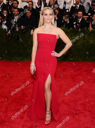 """Actress Reese Witherspoon arrives at The Metropolitan Museum of Art's Costume Institute benefit gala celebrating """"China: Through the Looking Glass,"""" in New York. Witherspoon, Misty Copeland, Caitlyn Jenner and five women touched by the South Carolina church massacre and lauded in the aftermath as The Peacemakers of Charleston are among this year's honorees as Glamour magazine's Women of the Year. Victoria Beckham, billionaire entrepreneur Elizabeth Holmes, Planned Parenthood's Cecile Richards and the women's FIFA soccer Team USA round out the Class of 2015, announced . They will be honored at a gala Nov. 9 at Carnegie Hall"""