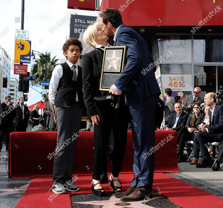 Actor Hugh Jackman, right, and his wife, actress Deborra-Lee Furness, share a kiss, while their son, Oscar Jackman, looks on at Hugh Jackman's star ceremony at the Hollywood Walk of Fame, in Los Angeles