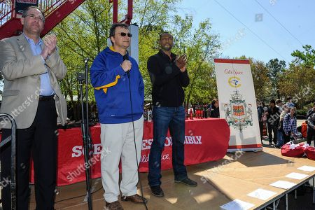 """As part of the national Old Spice Scent Responsibly school tour, the world-famous """"Old Spice Guy"""" Isaiah Mustafa, right, kicks off Chattahoochee High School's annual Springfest with Mayor Mike Bodker, left, and principal Tim Duncan on in Johns Creek, Ga"""