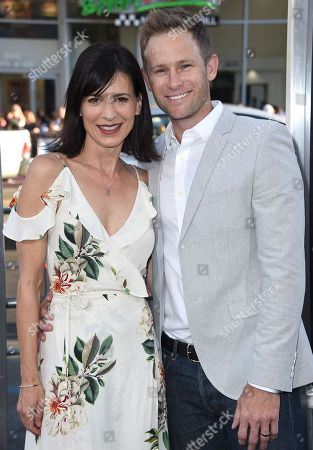 """Perrey Reeves, left, and Aaron Endress-Fox arrive at the Los Angeles premiere of """"War Dogs"""" at the TCL Chinese Theatre on"""