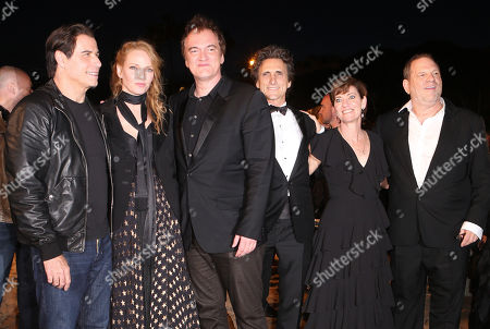 John Travolta, Uma Thurman, Quentin Tarantino Lawrence Bender, Harvey Weinstein and Zanne Devine pose together ahead of the beach screening of Pulp Fiction at Miramax's 20th Anniversary celebration of the film at Majestic Beach in Cannes, southern France, during the 67th international film festival