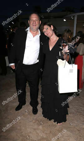 Harvey Weinstein, Co Chairman at Miramax, and Zanne Devine, Executive VP Production at Miramax, at Miramax's 20th Anniversary celebration of the film Pulp Fiction at Majestic Beach in Cannes, southern France, during the 67th international film festival