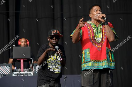 """Phife Dawg, left, and Q-Tip, from U.S group A Tribe Called Quest perform on stage during the Wireless Festival at the Queen Elizabeth Olympic Park, London. A Tribe Called Quest celebrated the 25th anniversary of its debut album, """"People's Instinctive Travels and the Paths of Rhythm,"""" in November 2015 by re-releasing the album with remixes helmed by Pharrell, CeeLo Green and J. Cole. The group said more re-releases will be issues for its other albums"""