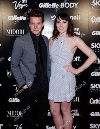 Actor Dave Thomas Brown, left, and actress Cait Fairbanks, right, attend Out Magazine Hot List Party, in New York