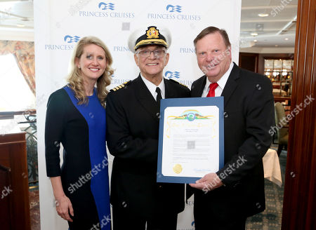 """IMAGE DISTRIBUTED FOR PRINCESS CRUISES - City of Santa Clarita Mayor Pro Tem, Bob Kellar, presents Jan Swartz, president of Princess Cruises, and Gavin MacLeod, Captain Stubing from """"The Love Boat,"""" with official proclamation declaring Dec. 3 """"Princess Cruises Day"""" on Thurs., in Los Angeles"""