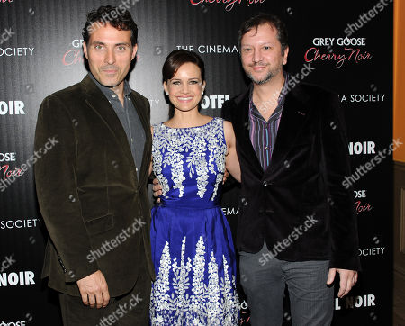 "Co-stars Rufus Sewell and Carla Gugino pose with writer and director Sebastian Gutierrez, right, at a special screening of ""Hotel Noir"" hosted by Gato Negro Films and The Cinema Society on in New York"