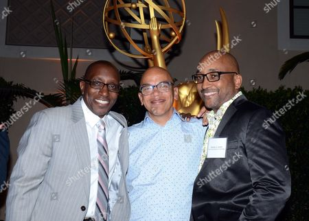 Greg Phillinganes, Rickey Minor, and Stanley A. Smith mingle at the Television Academy's 67th Emmy Music Nominee Reception at the Montage Beverly Hills on in Beverly Hills, Calif