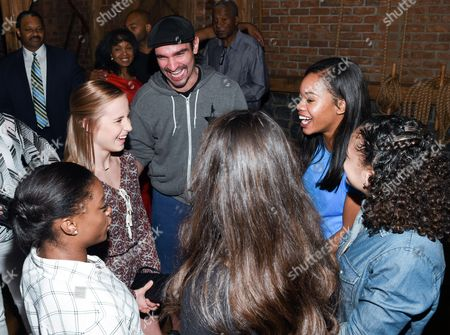 """Members of the """"Final Five"""" Rio Olympics gold medal-winning U.S. Gymnastics team, clockwise from left, Simone Biles, Madison Kocian, Gabby Douglas, Laurie Hernandez and Aly Raisman chat with """"Hamilton"""" star Javier Muñoz after attending the performance at the Richard Rogers Theatre, in New York"""