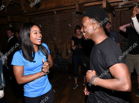 """U.S. Gymnastics gold medalist Gabby Douglas, left, meets """"Hamilton"""" cast member Gregory Haney backstage after attending the performance at the Richard Rogers Theatre, in New York"""