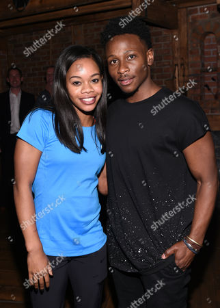 """U.S. Gymnastics gold medalist Gabby Douglas poses with """"Hamilton"""" cast member Gregory Haney backstage after attending the performance at the Richard Rogers Theatre, in New York"""