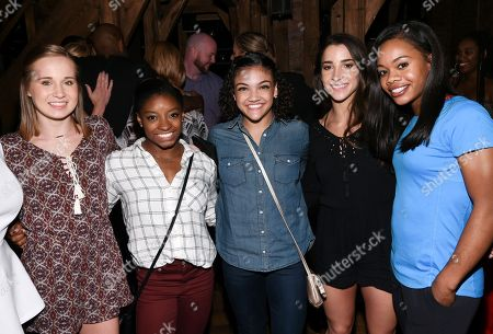 """Members of the """"Final Five"""" Rio Olympics gold medal-winning U.S. Gymnastics team, from left, Madison Kocian, Simone Biles, Laurie Hernandez, Aly Raisman and Gabby Douglas pose together backstage after attending performance of """"Hamilton"""" at the Richard Rogers Theatre, in New York"""