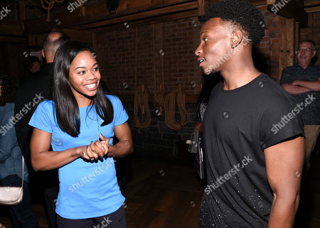"""U.S. Gymnastics gold medalist Gabby Douglas meets """"Hamilton"""" cast member Gregory Haney backstage after attending the performance at the Richard Rogers Theatre, in New York"""