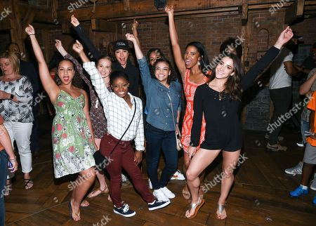 "Stock Picture of Members of the ""Final Five"" Rio Olympics gold medal winning U.S. Gymnastics team,Madison Kocian, Simone Biles, Gabby Douglas, Laurie Hernandez, Aly Raisman pose with ""Hamilton"" actors who play the Schuyler sisters, Jasmine Cephas Jones, Lexi Lawson and Renee Elise Goldsberry backstage after attending the performance at the Richard Rogers Theatre, in New York"