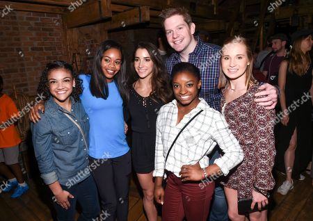 """Members of the """"Final Five"""" Rio Olympics gold medal-winning U.S. Gymnastics team, from left, Laurie Hernandez, Gabby Douglass, Aly Raisman, Rory O'Malley, Simone Biles and Madison Kocian pose with """"Hamilton"""" star Rory O'Malley backstage after attending a performance at the Richard Rogers Theatre, in New York"""