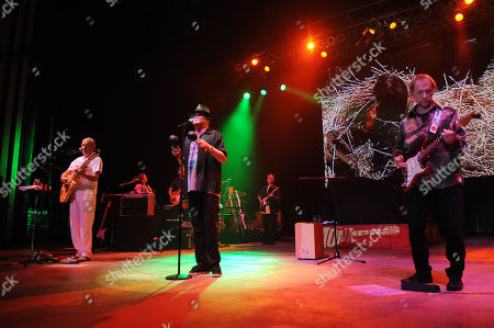 Michael Nesmith, Micky Dolenz and Peter Tork of The Monkees perform during the Mid Summers Night Tour at the Mizner Park Amphitheater on in Boca Raton, Florida