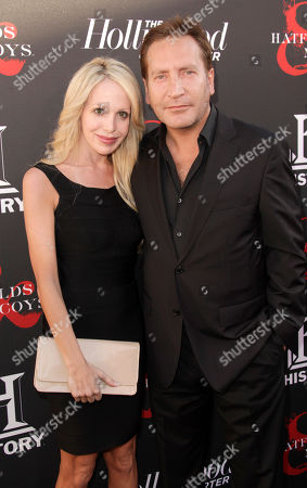 Stock Image of Actor Ronan Vibert (right) and guest arrive at the world premiere of Hatfields & McCoys on in Los Angeles