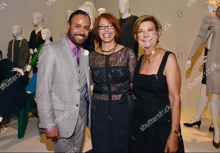 """Barbara Bundy, VP Education at FIDM, right, and Nick Verreos, FIDM spokesperson and fashion designer, left, and Diane Crooke, costume designer for """"Parenthood,"""" seen at the Television Academy's 66th Emmy Awards Costume Design and Supervision Nominee Reception at the Fashion Institute of Design & Merchandising, in Los Angeles"""