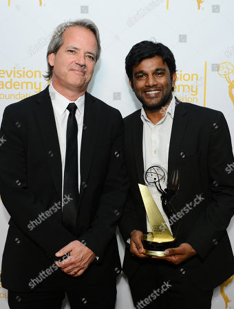 """Graham Yost, left, and Shubhashish Bhutiani, of School of Visual Arts with the Directing Award for """"Kush"""", pose in the press room at the 35th College Television Awards, presented by the Television Academy Foundation at The Leonard H. Goldenson Theatre in the NoHo Arts District, in Los Angeles"""