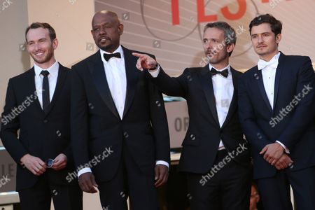 From left, actors Conrad Kemp, Forest Whitaker, director Jerome Salle, and actor Orlando Bloom arrive for the awards ceremony of the 66th international film festival, in Cannes, southern France