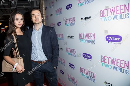Bethan Wright and Adrian Dulgher pose for photographers upon arrival at the premiere of the film 'Between Two Worlds' in London