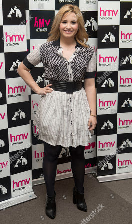 Stock Image of Demi Levato arrives at a HMV store in Oxford Street, central London, before the U.S singer meets fans and promotes her album