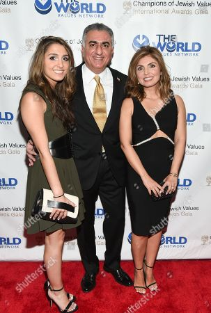 Crown Prince of Iran, Reza Pahlavi, center, poses with his daughter Iman Pahlavi, left, and wife Yasmine Pahlavi at the Champions of Jewish Values International Awards Gala at the Marriott Marquis, in New York