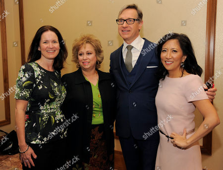 """Stock Image of Left to right, Regal Entertainment Group CEO Amy Miles, The Hollywood Reporter publisher and senior vice president Lynne Segall, director Paul Feig and The Hollywood Reporter editorial director Janice Min pose together before the """"Driving Financial Success: Women + Movies = Bigger Box Office"""" luncheon at CinemaCon 2013 at Caesars Palace on in Las Vegas"""