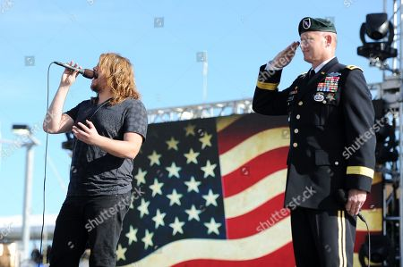 American Idol season thirteen winner Caleb Johnson performs The Star Spangled Banner prior to the Ford Ecoboost 400 at Homestead Miami Speedway on in Homestead, Fla
