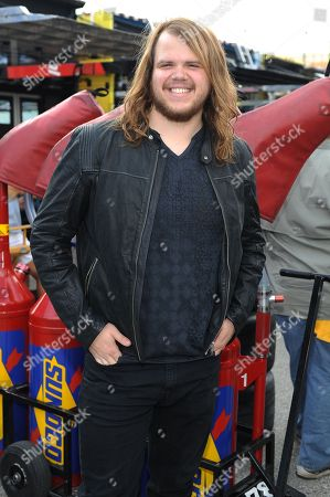 American Idol season thirteen winner Caleb Johnson appears during the Ford Ecoboost 400 at Homestead Miami Speedway on in Homestead, Fla