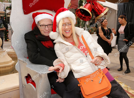Larry King and Beverly Hills Mayor Lili Bosse get in the holiday spirit at the Beverly Hills Holiday Bazaar, in Beverly Hills
