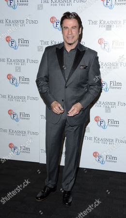 """John Travolta is seen at a Photocall for a BFI screening of Killing Season at the BFI Southbank in London on . John Travolta joins Ella Krasner to support The Krasner Fund for the BFI Collections â?"""" the largest archive of film and television in the world"""