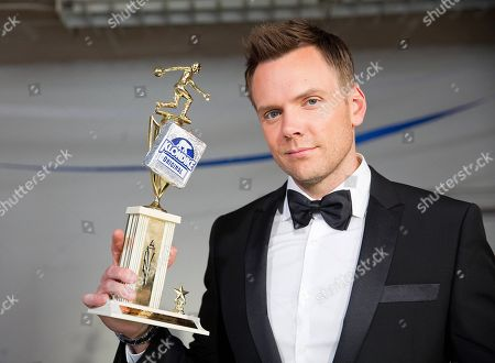 "IMAGE DISTRIBUTED FOR KLONDIKE"" Comedian Joel McHale shows off a priceless trophy on the set of The Klondy Awards, on Thursday, September 5th, 2013 in Northridge, CA. Alfonso Ribeiro, â?˜80s pop sensation Tiffany and former professional wrestler Rowdy Roddy Piper participated in a celebration of the challenges as part of the Klondike Celebrity Challenge. View Klondy Awards coverage, as well as the challenge videos, at Facebook.com/Klondike"