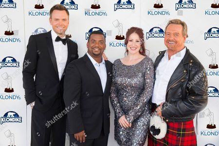 """IMAGE DISTRIBUTED FOR KLONDIKE"""" Comedian Joel McHale, actor Alfonso Ribeiro, â?˜80s pop sensation Tiffany and former professional wrestler Rowdy Roddy Piper pose on the blue carpet at The Klondy Awards, on Thursday, September 5th, 2013 in Northridge, CA. We now know what they were challenged to do, as part of the Klondike Celebrity Challenge, a comedic contest allowing fans to determine what celebrities should do for Klondike bars. View Klondy Awards coverage, as well as the challenge videos, at Facebook.com/Klondike"""