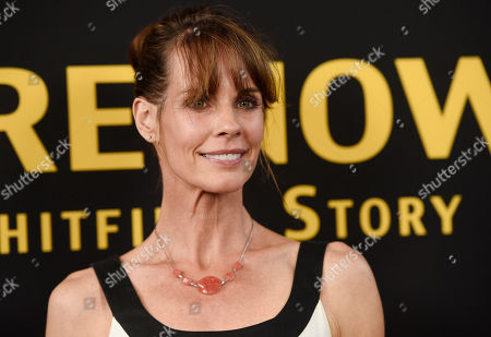"Actress Alexandra Paul poses at the premiere of the film ""Be Here Now (The Andy Whitfield Story),"" at the UTA Theater, in Beverly Hills, Calif"