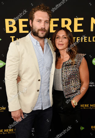 "Actor Jai Courtney and Vashti Whitfield, widow of actor Andy Whitfield, pose together at the premiere of the film ""Be Here Now (The Andy Whitfield Story),"" at the UTA Theater, in Beverly Hills, Calif. Whitfield died of non-Hodgkin lymphoma in 2011"