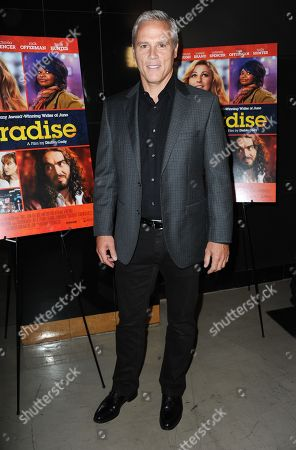 "Stock Image of Phil Austin arrives at at a special screening of ""Paradise"" at Chinese 6 Theater on in Los Angeles"