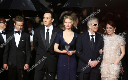 From left, Evan Bird, John Cusack, Mia Wasikowska, David Croneberg and Julianne Moore on the red carpet for the screening of Maps to the Stars at the 67th international film festival, Cannes, southern France