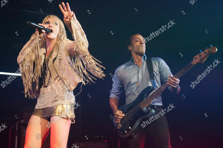 Singer Emily Haines and bassist Joshua Winstead of Metric perform at the Air Canada Centre, in Toronto