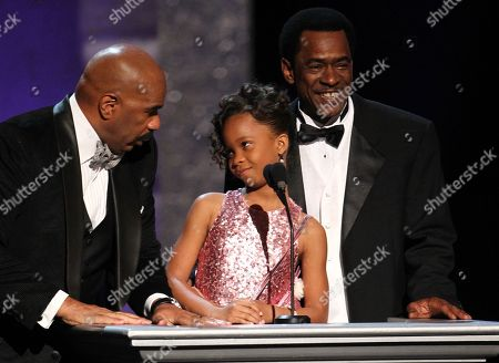 From left, host Steve Harvey, Quvenzhane Wallis and Dwight Henry speak onstage at the 44th Annual NAACP Image Awards at the Shrine Auditorium in Los Angeles on