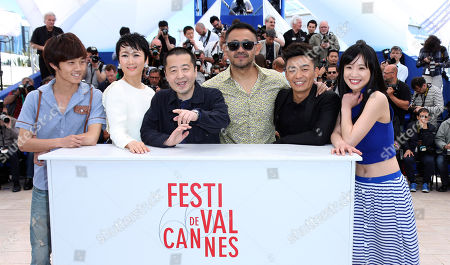 From right, actors Meng Li, Baoqiang Wang, Jiang Wu, director Jia Zhangke, Tao Zhao and Lanshan Luo pose for photographers during a photo call for the film A Touch of Sin at the 66th international film festival, in Cannes, southern France