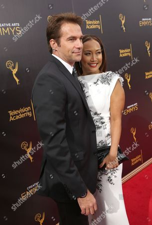 Robb Derringer, left, and Carrie Ann Inaba arrive at night two of the Television Academy's 2016 Creative Arts Emmy Awards at the Microsoft Theater on in Los Angeles