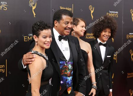 Miranda Tyson, from left, Neil deGrasse Tyson, Alice Young, and Travis Tyson arrive at night two of the Television Academy's 2016 Creative Arts Emmy Awards at the Microsoft Theater on in Los Angeles
