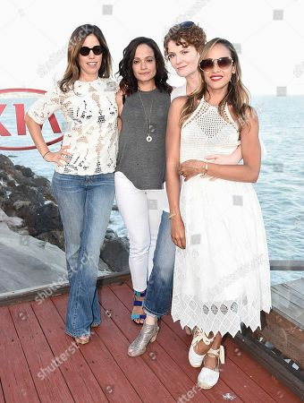 From left to right, actress Ana Ortiz, actress Judy Reyes, Rebecca Wisocky, actress Dania Ramirez at the Kia Malibu Beach House Presented by Teva on in Malibu, Calif. Ramirez, Martinez, Ortiz, Wisocky and Reyes later live tweeted an episode of their television show Devious Maids